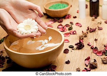 Spa.Woman's Hands with flower