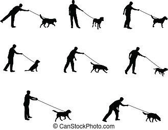 spazierenführen hundes, silhouetten