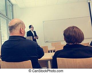 Speaker giving a presentation at business conference.