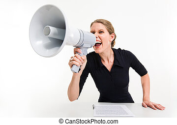 Portrait of businesswoman sitting at the table and speaking through megaphone