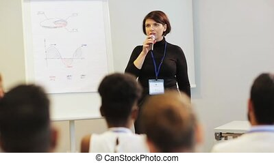 speaker with microphone at business conference - business,...