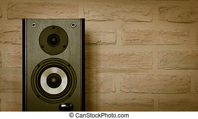 Speakers on the brick wall background