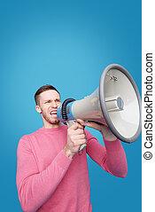 Speaking announcement into megaphone