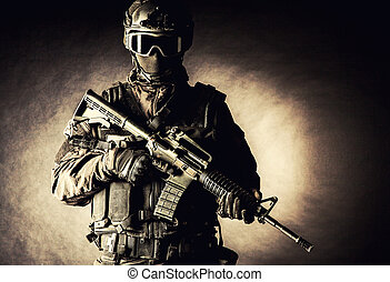 Spec ops police officer SWAT in black uniform and face mask