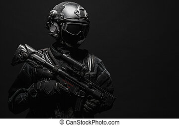 Spec ops police officer SWAT in black uniform and face mask...