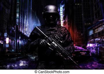 Spec ops police officer SWAT in black uniform on the street