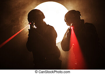 laser sights - Spec ops police officers SWAT in the smoke...