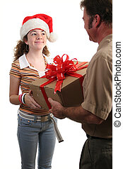 Special Christmas Delivery - a girl in a Santa hat receiving...