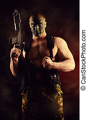 special forces - A soldier in war paint holding the...