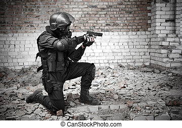 Special forces - Armed man in protactive cask with a pistol...