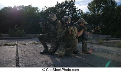 Special forces marines in defensive position - Elite squad...