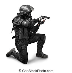 Special forces - Armed man in protactive cask with a pistol....