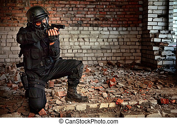 Special Forces - Armed man in protective cask with a pistol...