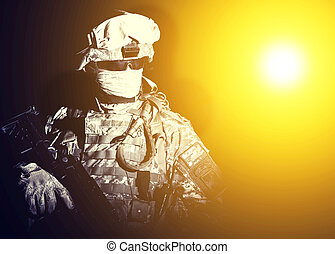 Special forces soldier in projector dazzling light