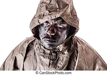 Special forces - a soldier wearing a poncho or raincoat and...