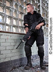 Special forces - Warrior with the machine gun on the ruined ...