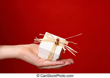 Special gift for you - Handing a small gift tied with raffia...