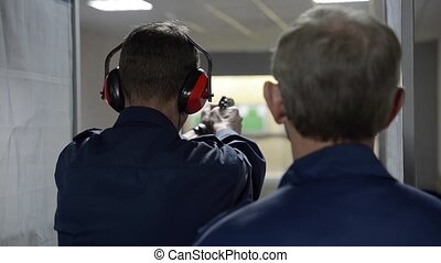 Special guard training in shooting with an instructor