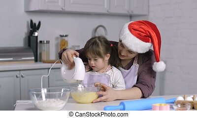 Special needs kid helps mom to cook xmas biscuit - Adorable...