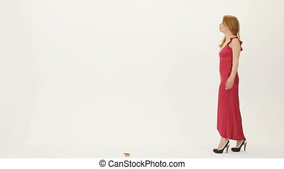 Special occasion - Beautiful woman in a red dress finding a...
