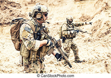 Special operations forces team raiding in desert