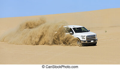 Special Utility Vehicle driving off-road on sand dune