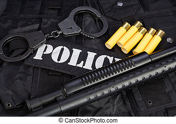 Special weapons and tactics team equipment on black background
