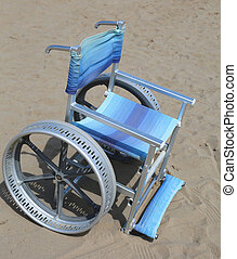 special wheelchair on the sand of the beach