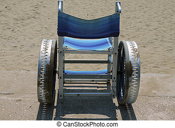 Special wheelchair to move around on the sand of the beach in summer