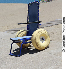 Special wheelchair with large floats wheels to go in the sea