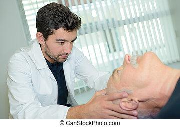 Specialist positioning patient's head