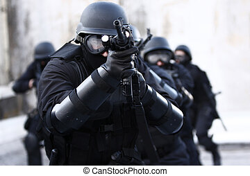 Specialized Police Unit - SWAT officers in full tactical ...