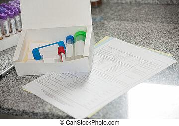 Specimen Bottles And Documents In Lab - Specimen bottles in...