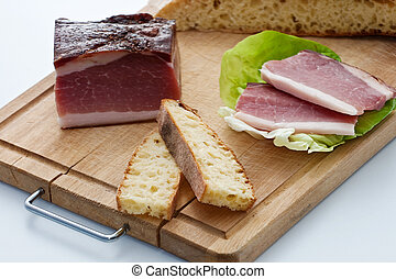 Speck ham on a cutting board