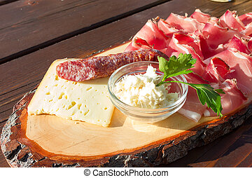 Speck salami and cheese with horseradish sauce