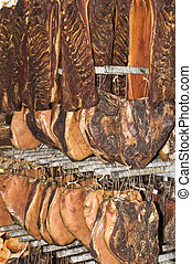 Speck - Hanged speck (salted and smocked ham) pieces drying...