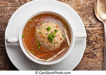 speckknoedel, a tyrolean dumpling in broth