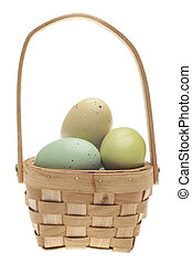 Speckled Easter Eggs in a Basket Isolated on White with a...