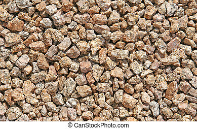 Speckled Rocks - Close-up of brown and gray rocks speckled...