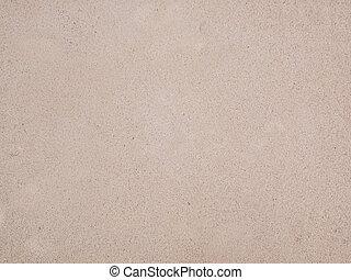 Speckles on an ecru surface.