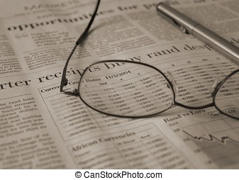 Spectacles and news - Spectacles on newspaper stock report,...