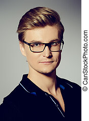spectacles - Portrait of a handsome young man in spectacles.