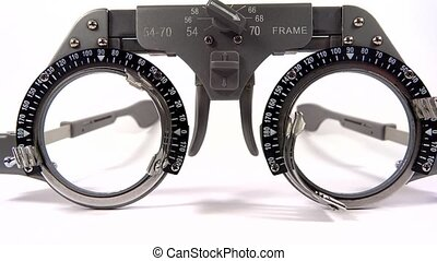 Spectacles used for eyesight tests with various lenses and...