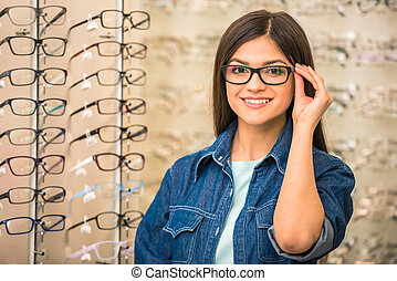 Spectactacles store - Portrait of happy young woman buying a...