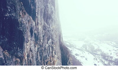 Spectacular 4k aerial flying near great limestone wall in a...