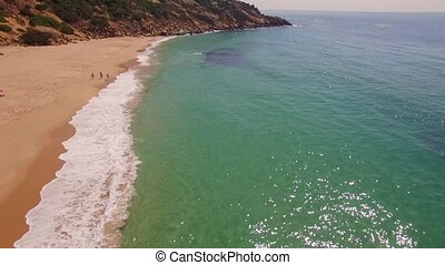 Spectacular Aerial Flight Over Spanish Beach and Cliffs