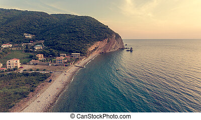 Spectacular aerial view of coastline at sunset.