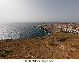 Spectacular coastal view of Playa Amarilla with desert landscape.