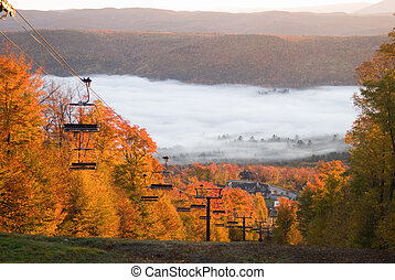 Spectacular fall landscape - Chairlift climbing on a fall ...