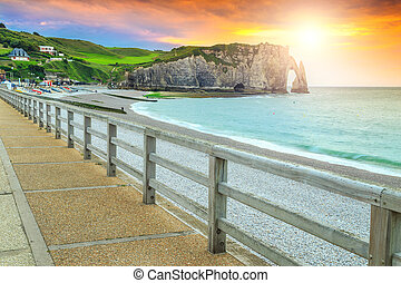 Spectacular gravel beach and magical colorful sunset Etretat, Normandy, France